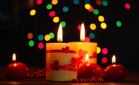 Beautiful candles on wooden table on bright background Stock Photo - 13864474