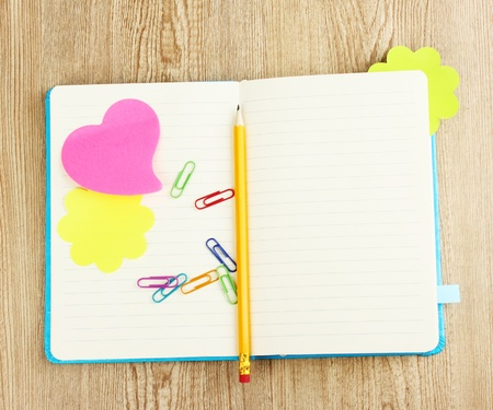 stickies: Open note book with stickies and pencil on wooden background Stock Photo