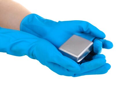 Uranium in hands isolated on white photo