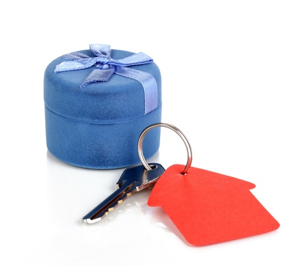 Key with house-shaped charm and box isolated on white photo