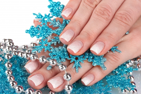 beautiful hands and snowflakes and beads isolated on white photo