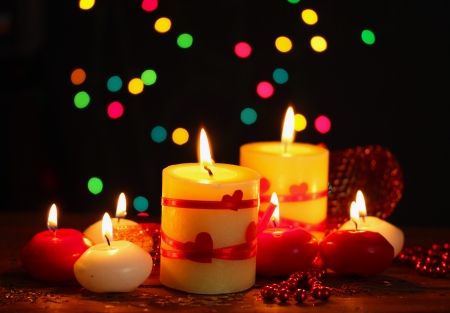 Beautiful candles on wooden table on bright background Stock Photo - 13878332