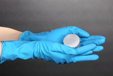 Uranium in hands on grey background Stock Photo - 13878338