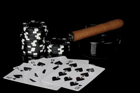 straight flush: straight flush with poker chips on black background Stock Photo