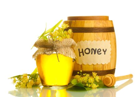 jar and barrel with linden honey and flowers isolated on white Stock Photo - 13901603
