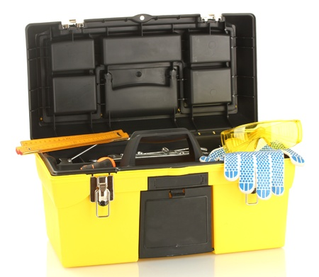 Open yellow tool box with tools isolated on white background photo