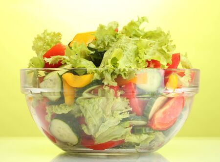 fresh vegetable salad in transparent bowl on green background Stock Photo - 13901558