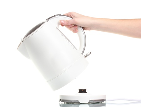 electric kettle: Womens hand and white electric kettle isolated on white Stock Photo