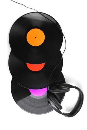 Black vinyl records and headphones isolated on white photo