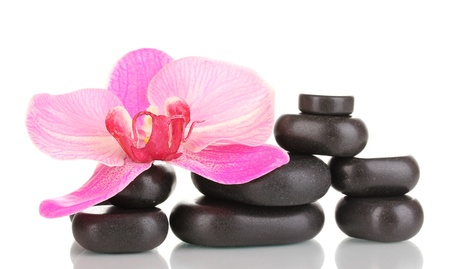 Spa stones with orchid flower isolated on white photo