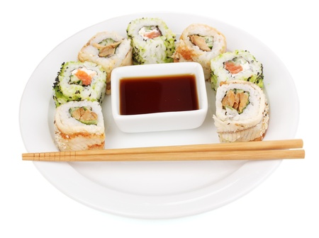 Tasty rolls served on white plate with chopsticks isolated on white photo