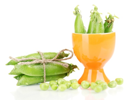 Green peas in glass isolated on white photo