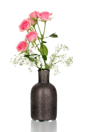 Pink roses in vase isolated on white Stock Photo - 13941139