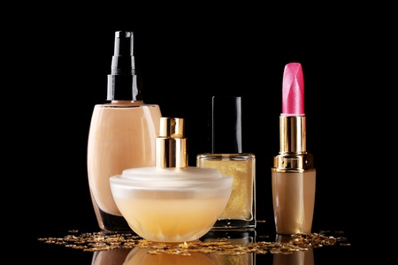 cosmetics isolated on black photo