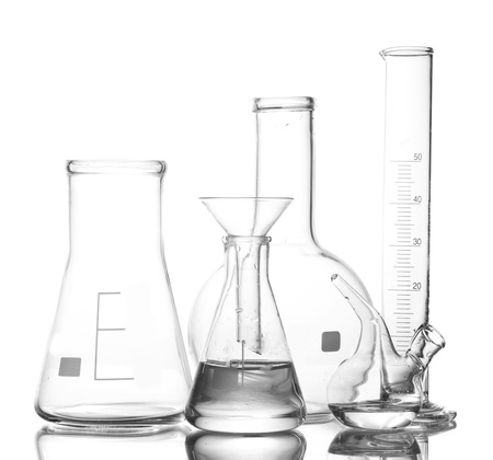 Different laboratory glassware with water and empty with reflection isolated on white photo