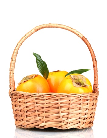Appetizing persimmons with leaves in pad isolated on white Stock Photo - 13941159