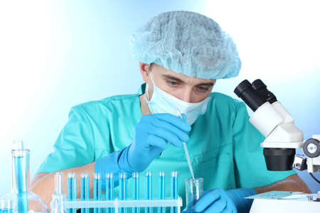 scientist in the lab working with chemicals test-tubes Stock Photo - 14934933