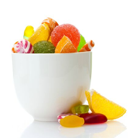 colorful jelly candies in bowl isolated on white photo