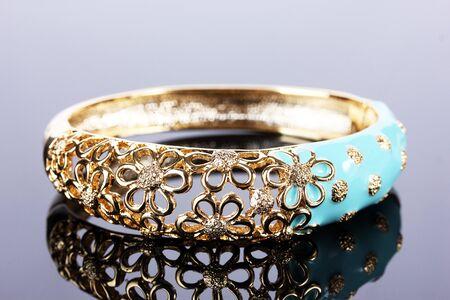 Beautiful golden bracelet on grey background Stock Photo - 13944662