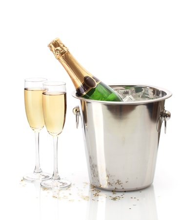 champagne bottle: Champagne bottle in bucket with ice and glasses of champagne, isolated on white Stock Photo