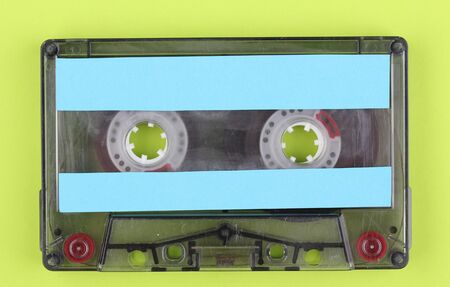 Audio cassette with color label on green background photo