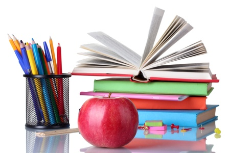 exercise book: Composition of books, stationery and an apple isolated on white