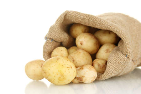 young potatoes in a sack isolated on white close-up photo