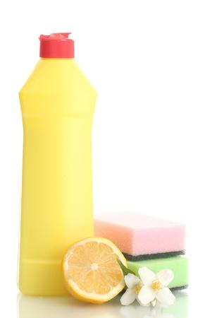 Dishwashing liquid with sponges and lemon with flowers isolated on white  photo