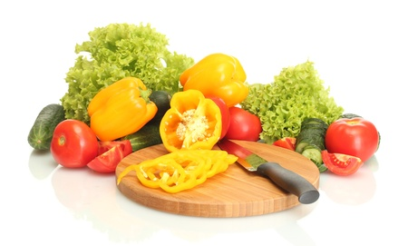 fresh vegetables and knife on cutting board isolated on white photo