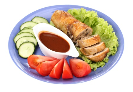 Tasty meat cutlet with garnish on plate photo
