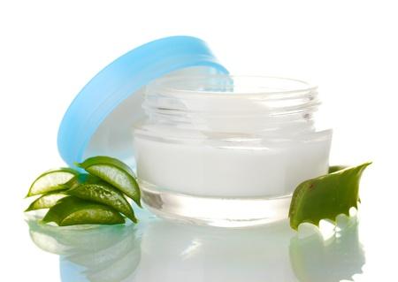 Aloe vera and cream isolated on white photo