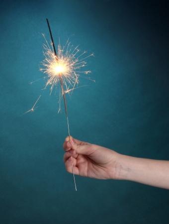 beautiful sparkler on blue background Stock Photo - 14011636