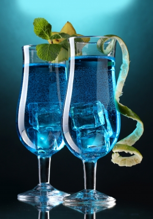 Blue cocktail in glasses on blue background photo