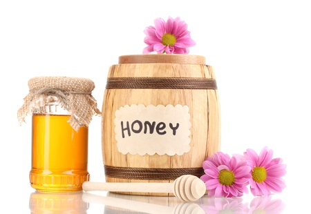 Sweet honey in barrel and jar with drizzler isolated on white Stock Photo - 13999942