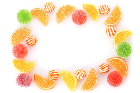 bonbons: frame of colorful jelly candies isolated on white