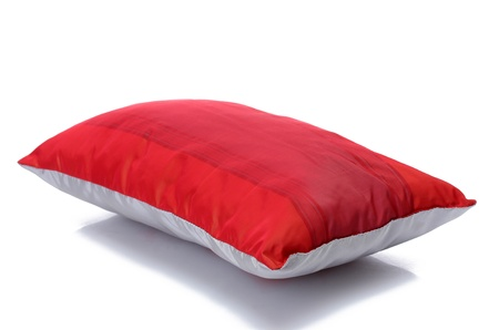 red bright pillow isolated on white photo