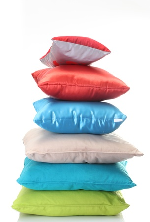 bright pillows isolated on white photo