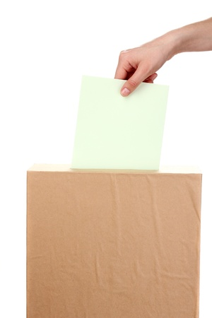 Hand with voting ballot and box isolated on white Stock Photo - 14011411