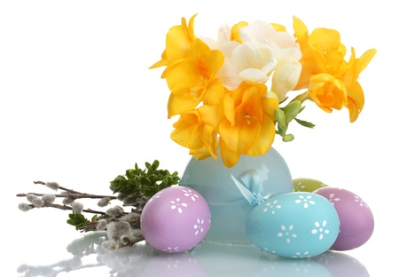 Beautiful yellow freesias in vase, Easter eggs and willow twigs isolated on white Stock Photo - 13998029