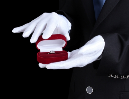 show ring: Mans hands holding ring in box
