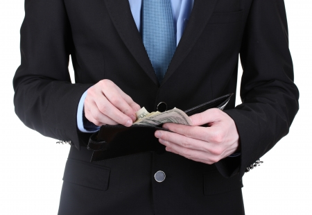 business man taking money in wallet isolated on white photo