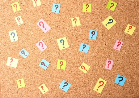 Many question marks on cork board Stock Photo - 14014422