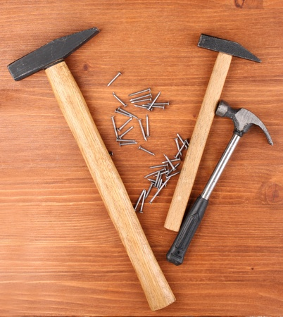 Hammers and metal nails on wooden background Stock Photo - 14011637