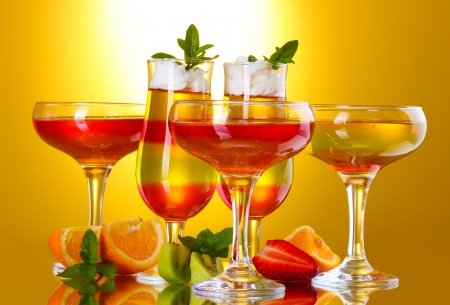 fruit jelly in glasses and fruits on yellow background Stock Photo - 14011616