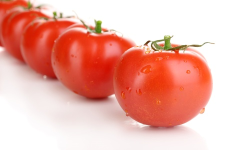 Fresh tomatoes isolated on white photo