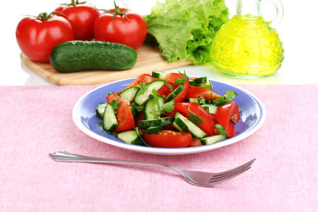 Fresh salad with tomatoes and cucumbers photo