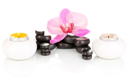 Spa stones with orchid flower and candles isolated on white Stock Photo - 14058444