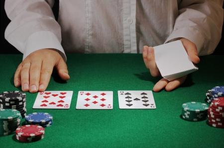 holdem: Poker setting on green table