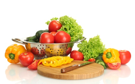 fresh vegetables and knife on cutting board isolated on white Stock Photo - 14053582