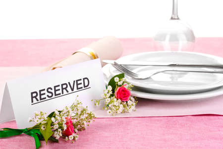 Table setting with reserved card in restaurant Stock Photo - 14052594